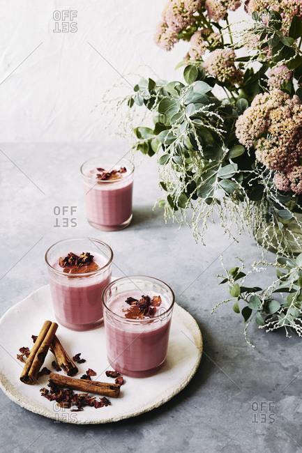 rose latte: almond milk, beetroot powder, rose syrup, cinnamon, honey, rose petals