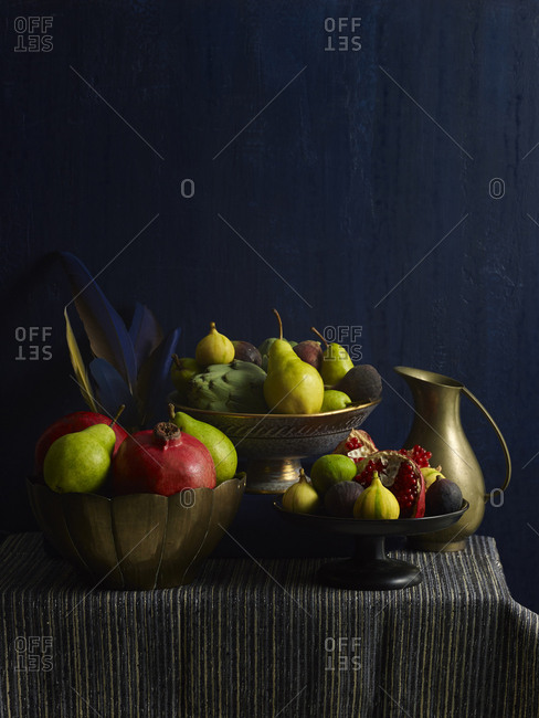 Autumn still life with fruit, feathers and jug and deep blue tones