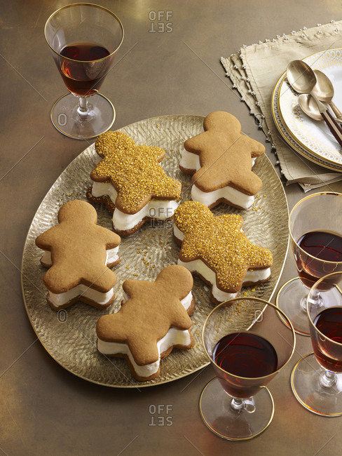 Gingerbread ice cream sandwiches served on gold platter with port wine