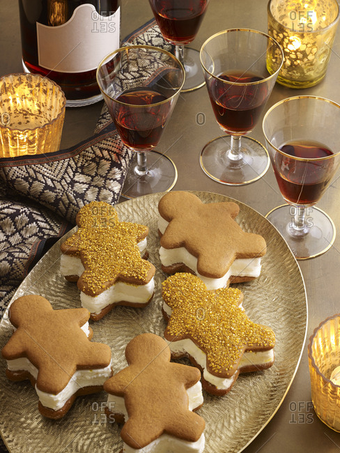 Gingerbread ice cream sandwiches served with port on gold platter with ribbon