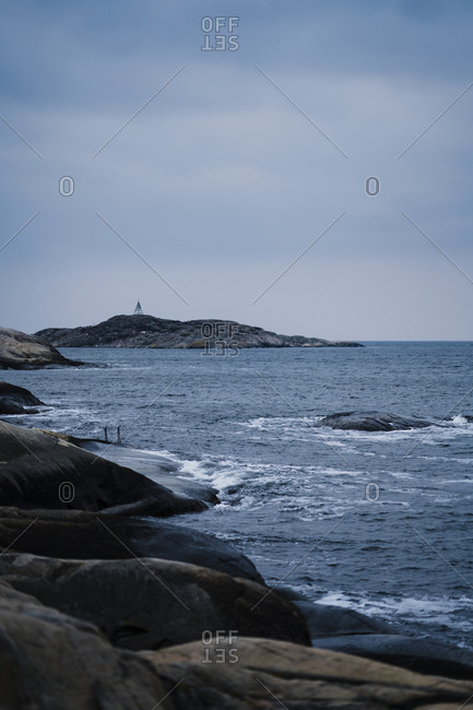 A ladder extends from a rocky shoreline in Sweden