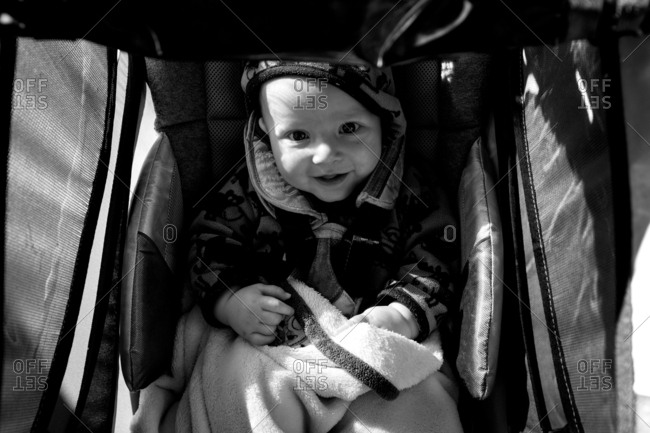 Portrait of a smiling baby in stroller