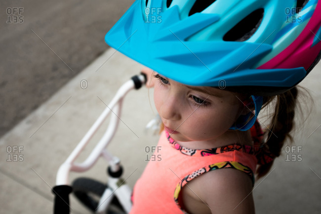 Portrait of a girl wearing a bicycle helmet