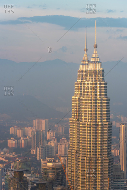 Kuala Lumpur, Malaysia - March 22, 2018: Petronas Twin Towers at sunset with the skyline of Kuala Lumpur in the background