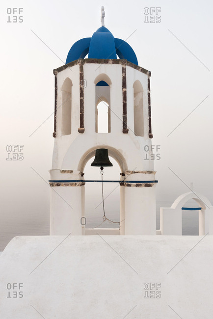 Bell tower in Santorini at sunset, Greece