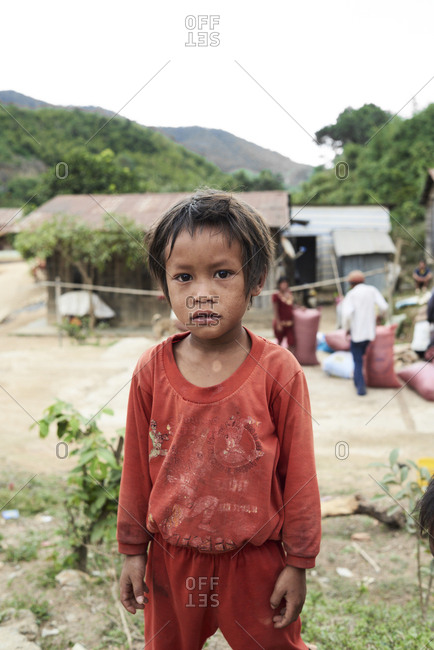 Central Highlands, Vietnam - January 9, 2018: Portrait of minority ethnic kid at village