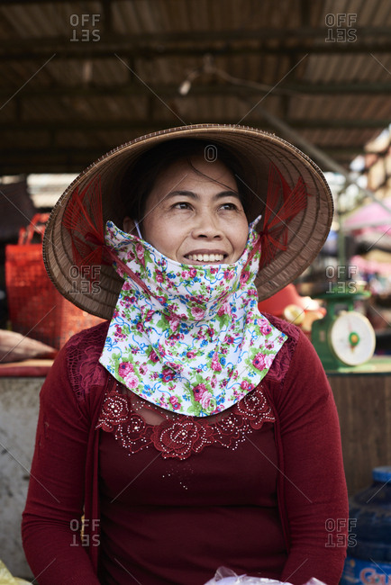 Central Highlands, Vietnam - January 9, 2018: Traditional vietnamese female wearing hat and mask smiling