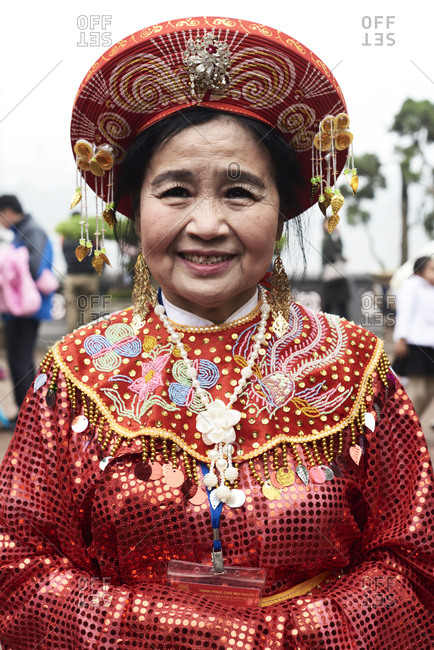 Hanoi, Vietnam - February 24, 2018 - Portrait of vietnamese senior woman wearing traditional costume during Tet celebration inside Ngoc Son temple