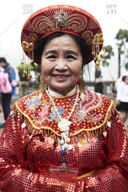 Hanoi, Vietnam - February 24, 2018 - Portrait of vietnamese senior woman wearing traditional costume during Tet celebration inside Ngoc Son temple