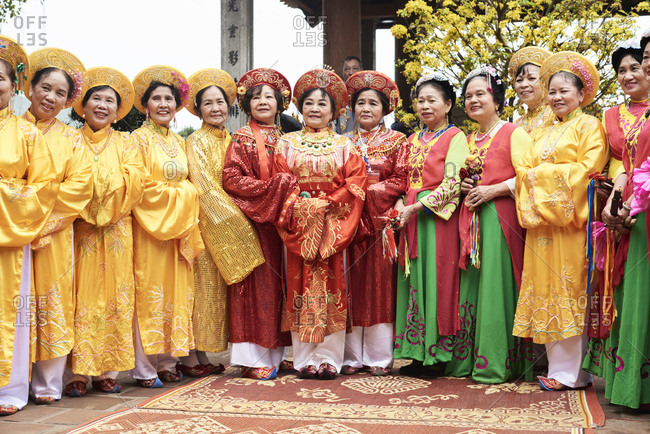 Hanoi, Vietnam - February 24, 2018 - Group of vietnamese senior women wearing traditional costume during Tet celebration inside Ngoc Son temple