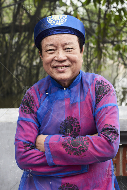 Hanoi, Vietnam - February 24, 2018 - Portrait of vietnamese senior man wearing traditional costume during Tet celebration inside Ngoc Son temple
