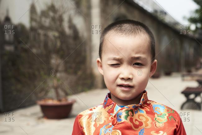 Hanoi, Vietnam - February 28, 2018 - Portrait of vietnamese child wearing traditional costume during Tet celebration