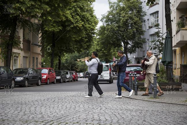 Berlin, Germany - June 13, 2017: Street musicians walking around the streets of Neukolln