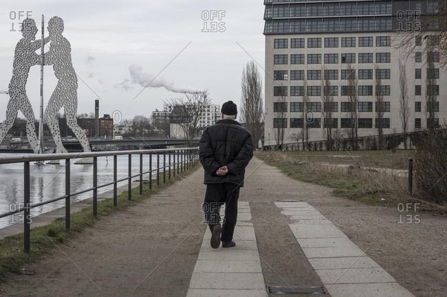 Berlin, Germany - February 24, 2015: A man walks near the Molecule Men