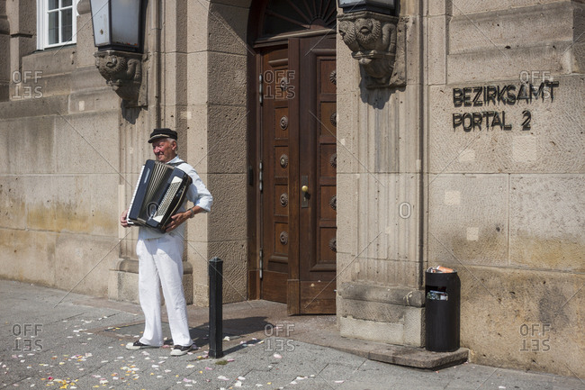 Berlin, Germany - August 15, 2015: An accordionist playing for a wedding party
