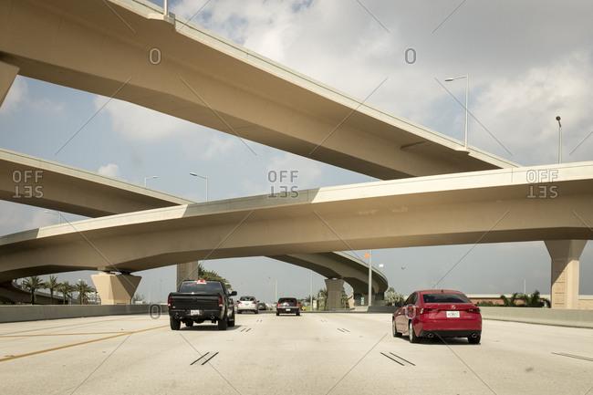 Florida, USA - September 20, 2017: Cars traveling along multi lane highway under overpass