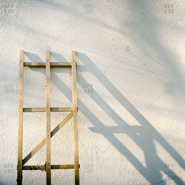 Wooden trellis leaning against outside wall