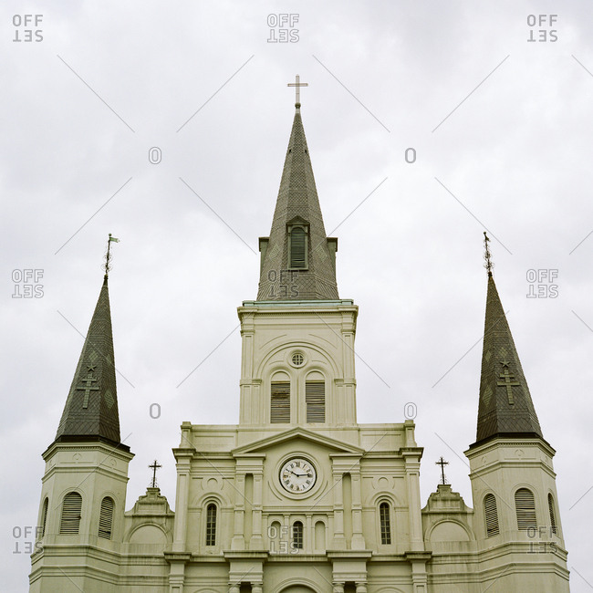 Exterior of historic church with steeples and clock
