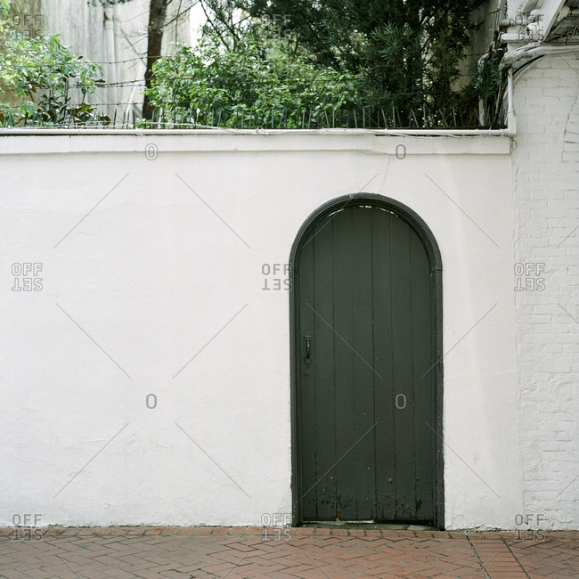 Arched doorway in white exterior wall