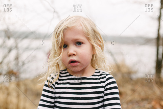 Portrait of little girl looking questioningly at camera