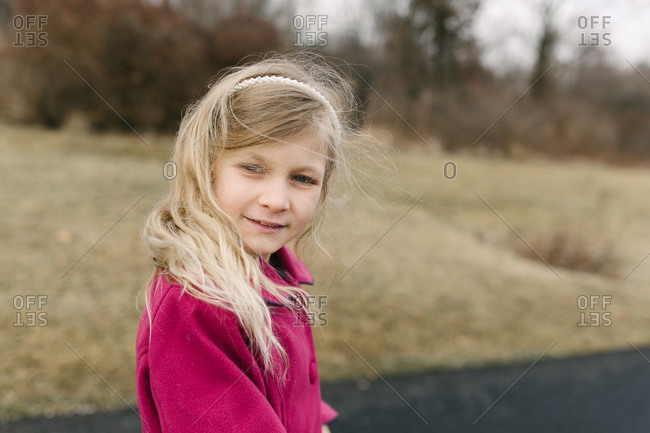 Young girl looking back over shoulder while walking