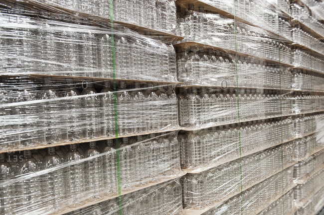 Close-up of pallets of bottled water in a bottling plant.