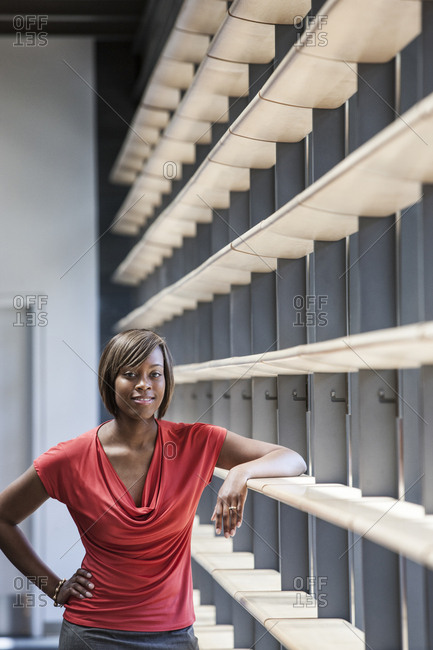 Black businesswoman in the lobby of a large office building.