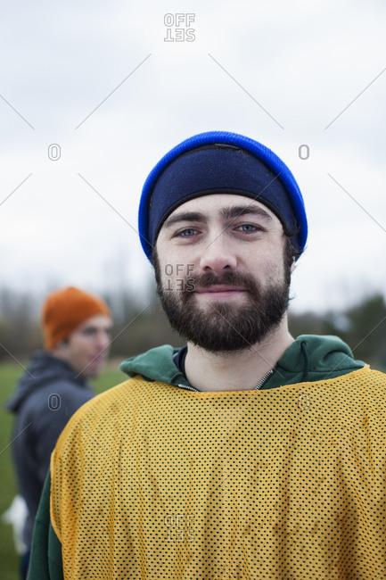Portrait of a bearded Caucasian man in sports gear, outdoors.