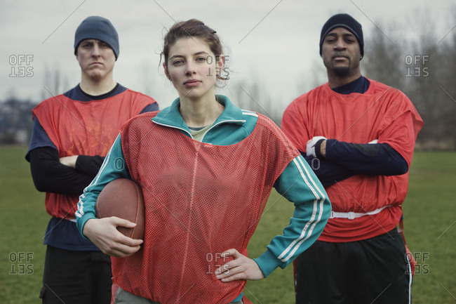 Two men and a woman, members of a team of American flag football players.