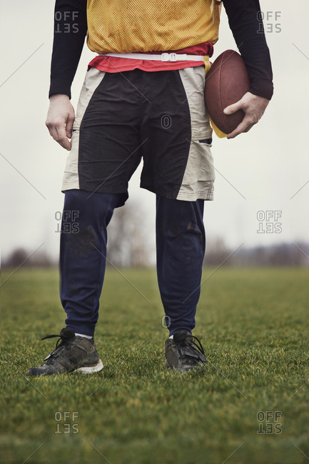 Close up view from the waist down of a male who is playing non-contact flag football.
