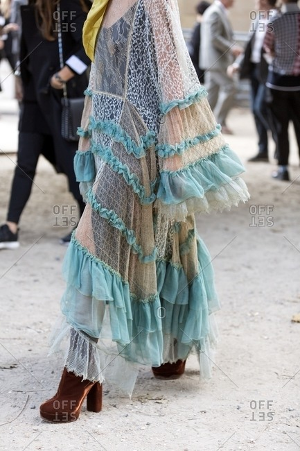 Woman wearing lace Kaftan with frills and velvet platform boots