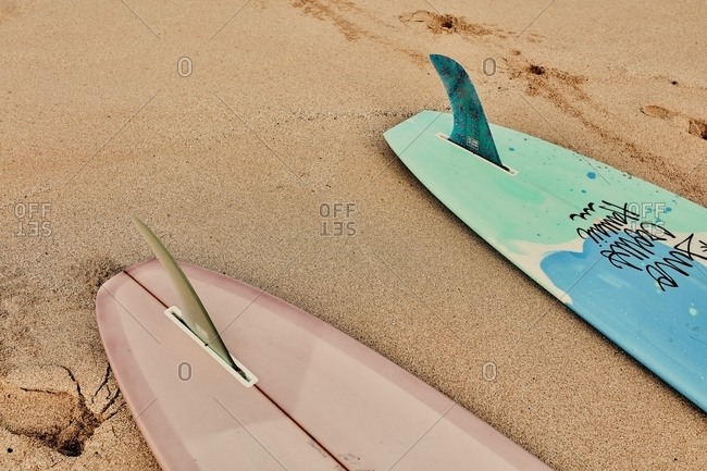 Hawaii - March 16, 2018: ! Two surfboards on sandy beach
