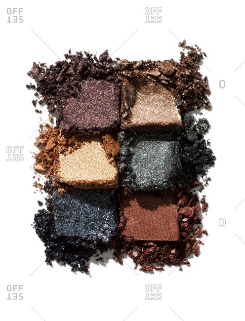 Overhead view of squares of crumbly earth tone materials