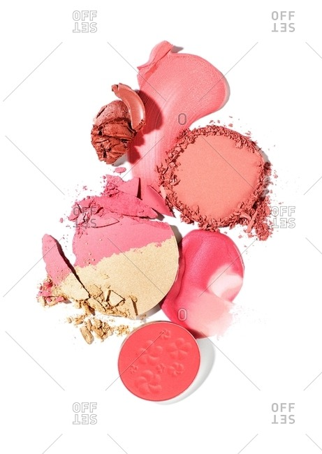 Cosmetic cakes, lotions and pastes in shades of pink