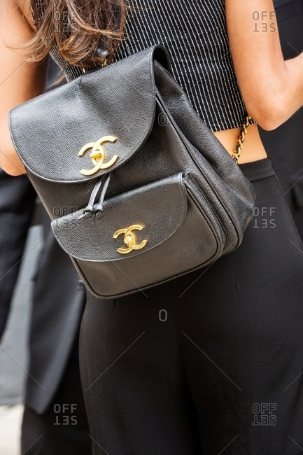 New York, USA - October 20, 2015: Rearview of woman wearing black carrying Chanel backpack