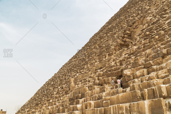 Pyramids of Giza, Cairo, Egypt - April 8, 2017: Side view of Great Pyramid of Giza