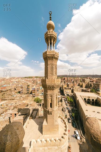 Islamic Cairo, Cairo, Egypt - April 13, 2017: View of minaret of Zuwayla Door against cloudscape