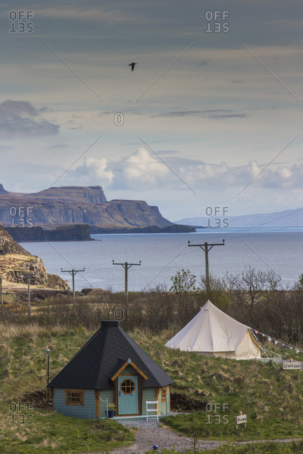 Isle of Skye, Isle of Skye, Scotland - April 26, 2017: Small cabins on shore