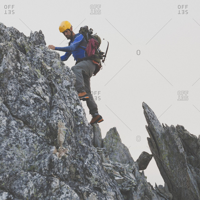 Mountain climber climbing on Ashlu Mountain, Coast Mountain Range, Squamish, British Columbia, Canada
