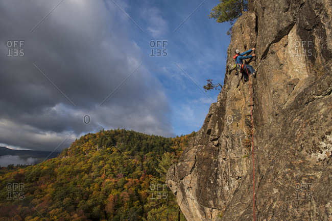 Low angle view of person climbing on mountain, New Hampshire, USA