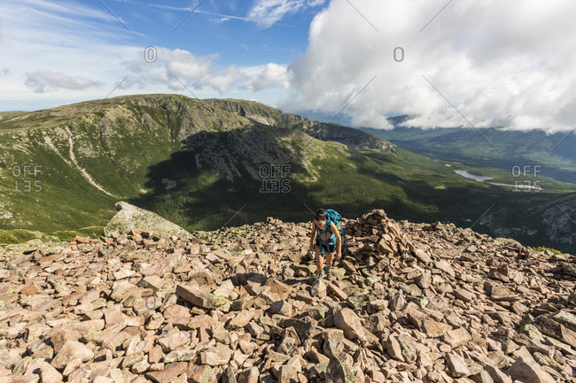 Teenage girl hiking at top of Cathedral Trail on Mount Katahdin in Baxter State Park, Maine, USA