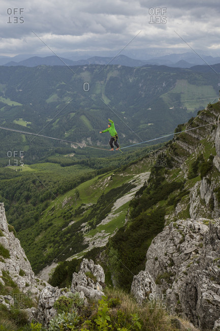 Man highlining on tightrope in Lower Alps, Lower Austria, Austria