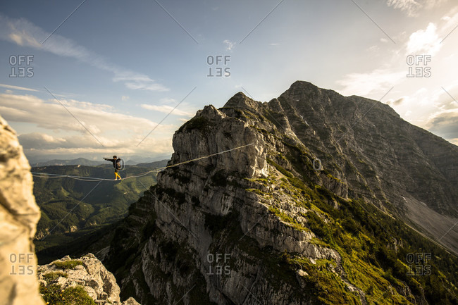 Man highlining on tightrope in Lower Alps, Lower Austria, Austria