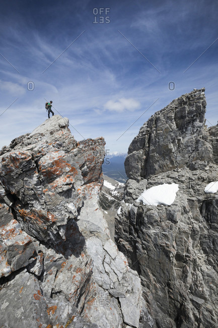 Mountain climber at summit of Mount Rundle, Banff National Park, Kananaskis Country, Alberta, Canada