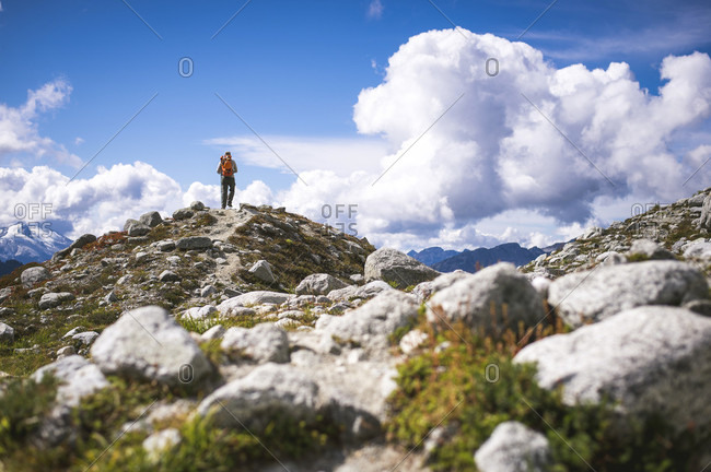 Backpacker hiking in North Cascades National Park, Washington State, USA