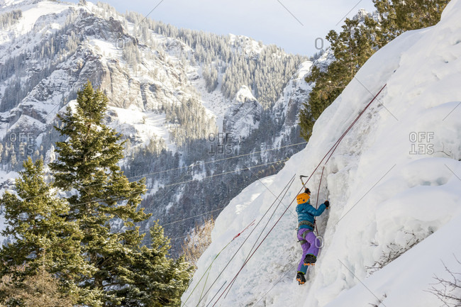 Side view of young girl ice climbing at kids wall, Ouray Ice Park, Ouray, Colorado