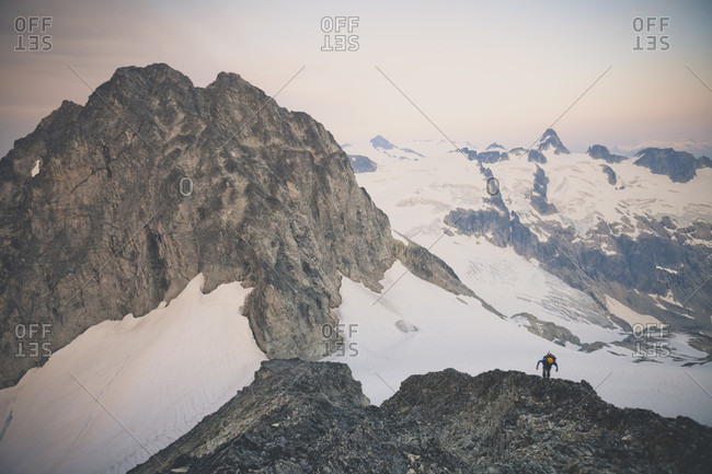 Rear view of person mountaineering on Ashlu Mountain in Coast Mountain Range of British Columbia, Canada