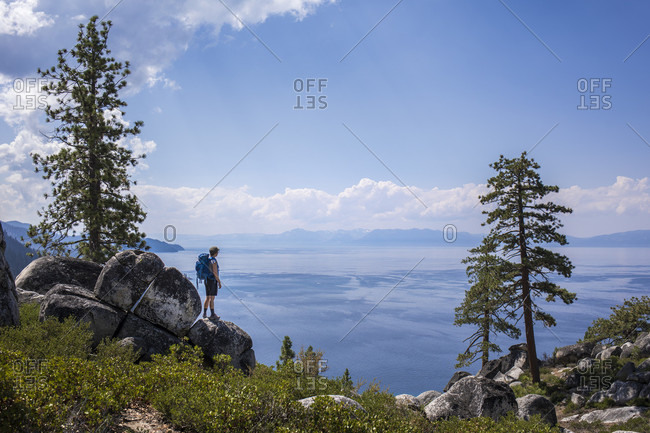 Young female hiker looking at view of Lake Tahoe, Nevada, USA