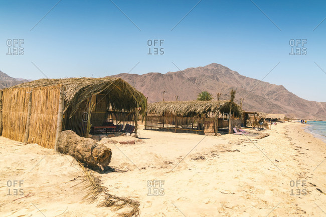 Straw huts for accommodation on beach during daytime, Nuweiba, Southern Sinai, Egypt