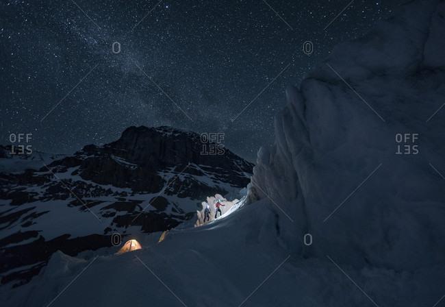 Ice climbers at night at Athabasca Glacier, Jasper National Park, Alberta, Canada